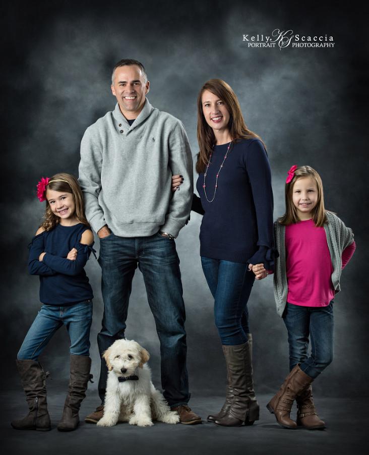 Family Studio Portrait With Dog
